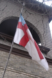 Episcopal flag and bell tower of St. John the Divine in Burlington, Wisconsin.